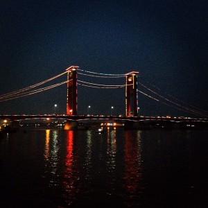 Palembang nights. Ampera bridge and Musi river.